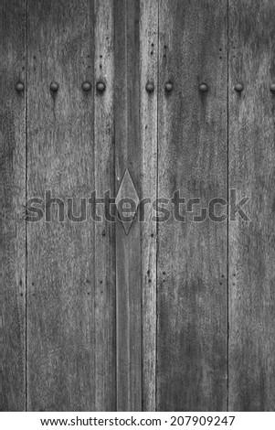 detail ancient wood doors black and white - stock photo