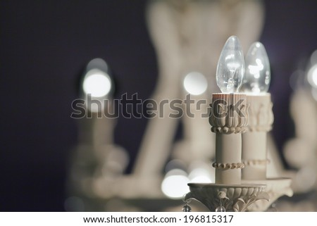 detail close up decorative porcelain chandelier with bulbs and crystal - stock photo