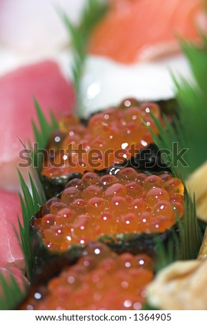 detail close up of salmon eggs - stock photo