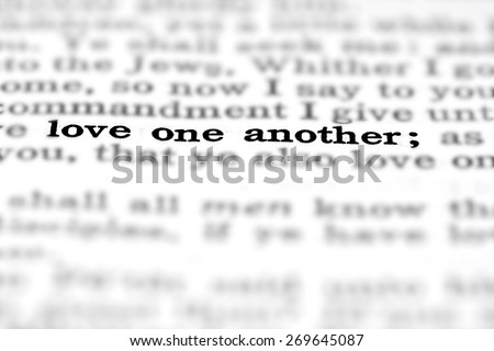Detail closeup of New Testament Scripture quote Love One Another - stock photo