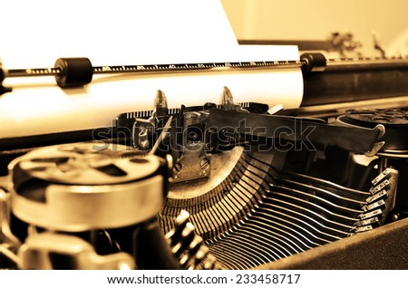 Detail closeup of old typewriter with paper for writing communication - stock photo