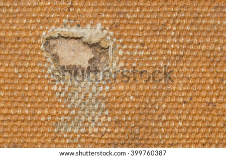 Detail (damage) of an old canvas suitcase, close-up, vintage look - stock photo