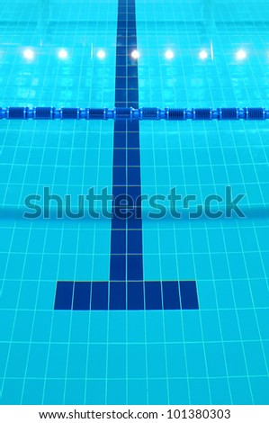 Detail from indoor swimming pool, water and lines - stock photo