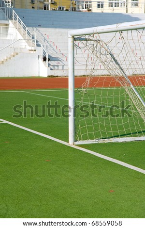 Detail from soccer pitch, goal on artificial grass - stock photo
