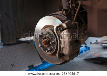 Detail image of car's break assembly after repair. - stock photo