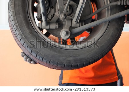 Detail image of mechanic hand, changing tyre of car, focus in hand - stock photo
