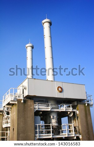 Detail image of the gate hydraulics at the Dutch Delta Works water barrier. - stock photo
