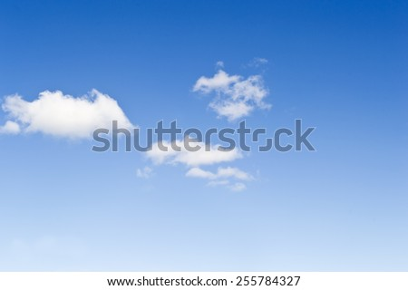 Detail of a beautiful blue sky with some white clouds - stock photo