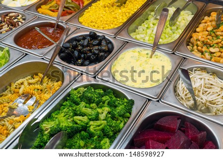 Detail of a beautiful salad buffet with a rich choice - stock photo