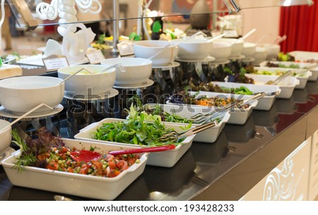 Detail of a beautiful salad buffet with a rich choice, healthy food - stock photo