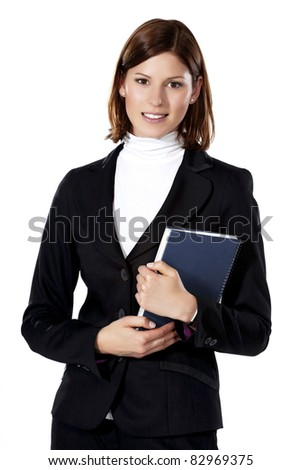 Detail of a beautiful young businesswoman holding a notebook - stock photo