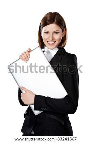 Detail of a beautiful young businesswoman holding laptop both hands - stock photo