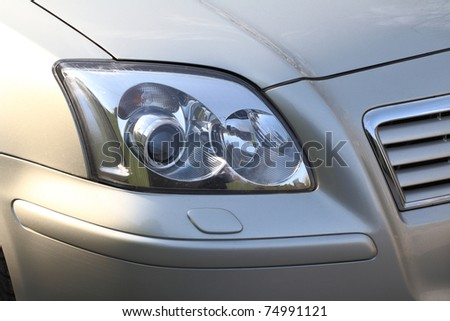 Detail of a beauty and fast car with headlight - stock photo
