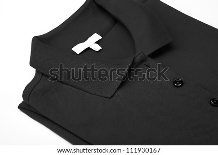 Detail of a black polo shirt. - stock photo