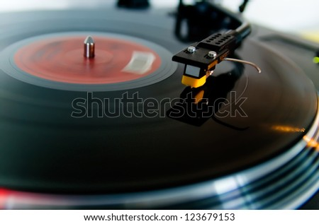 Detail of a black turntable in motion. - stock photo