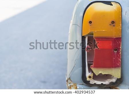 Detail of a broken brake light of vintage old truck.  - stock photo