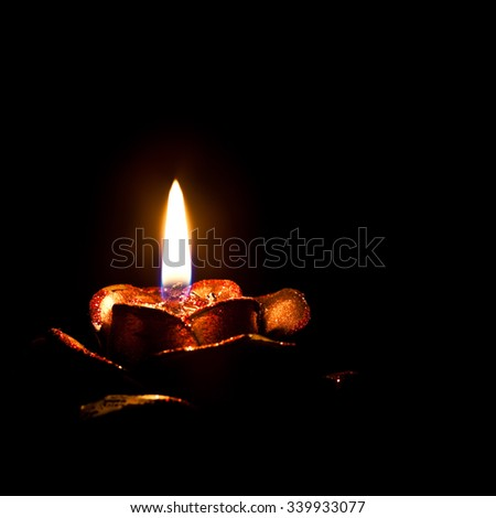 Detail of a burning candle on a black background - stock photo