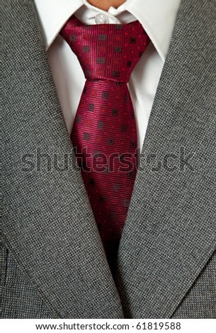detail of a business man suit with colored tie - stock photo
