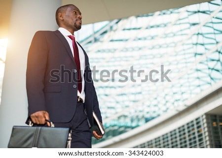 Detail of a businessman holding his briefcase - stock photo