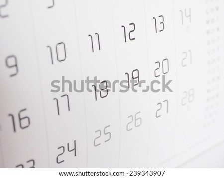 Detail of a calendar page with dates - stock photo