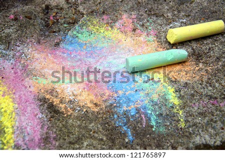 Detail of a childs colorful chalk painting on the pavement - stock photo