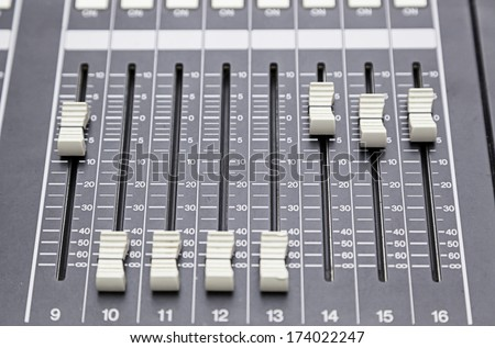 Detail of a concert mixer, mixer to control the volume and music, exploration and entertainment - stock photo