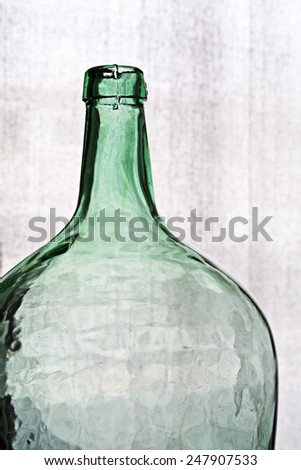 Detail of a crystal bottle against a clear background - stock photo
