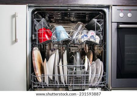 detail of a dishwasher - stock photo
