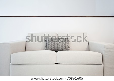 detail of a double seat sofa with cushions - stock photo
