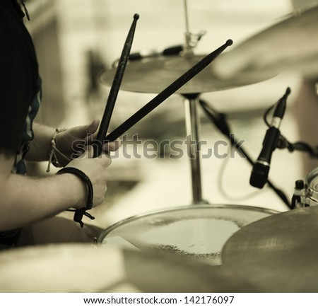 detail of a drummer on the rock concert - stock photo