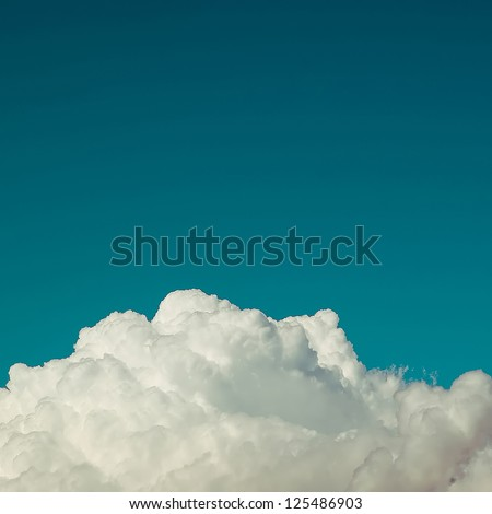 Detail of a fluffy cumulus cloud. - stock photo