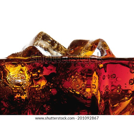 Detail of a glass of cola with ice isolated on white background - stock photo