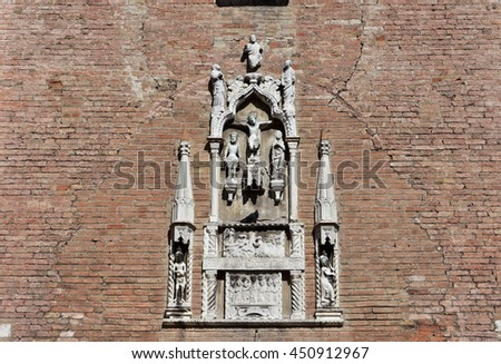 Detail of a gothic relief with Jesus Christ life and crucifixion, from Sant'Aponal medieval church in Venice (now closed)  - stock photo