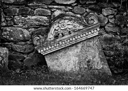 Detail of a grave into a cemetery in black and white - stock photo