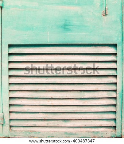 detail of a green window with shutters - stock photo