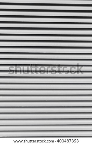 detail of a grey window with shutters  - stock photo