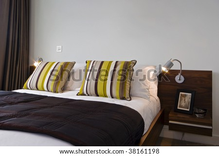 detail of a king size bed with luxury elements - stock photo