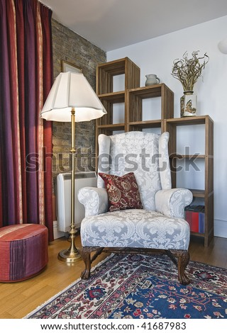 detail of a living room with armchair and book shelves - stock photo