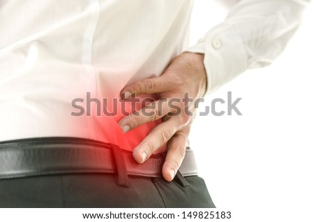Detail of a mans back with localized paint in his lower back. - stock photo