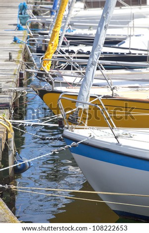 Detail of a marina with sailing boats - stock photo