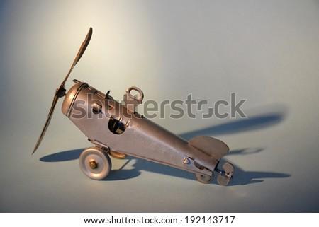 Detail of a mechanical tin toy aeroplane - stock photo