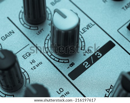 Detail of a mobile soundboard mixer for live music - cool cyanotype - stock photo