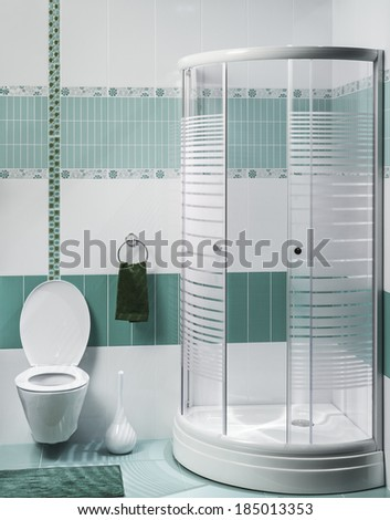 detail of a modern bathroom interior with luxury shower, green and white tiles  - stock photo