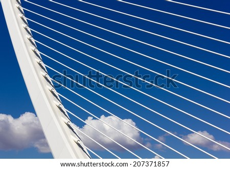 Detail of a Modern Bridge against a Blue Sky - stock photo