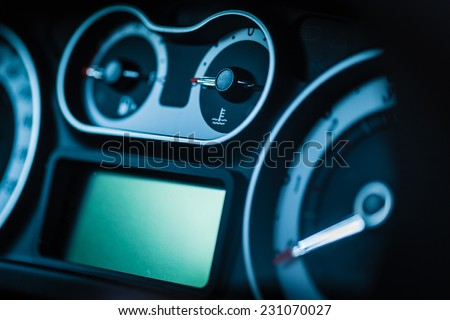 detail of a modern car dashboard with various gauges - stock photo