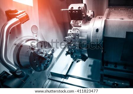 Detail of a modern CNC machine - stock photo