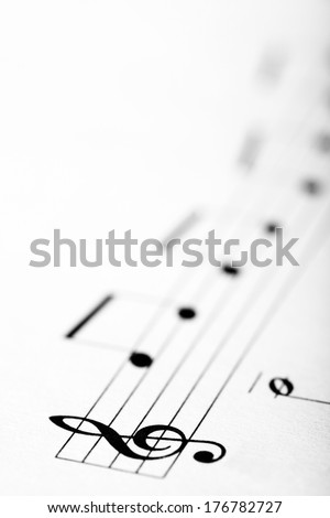Detail of a music sheet with the G clef - stock photo