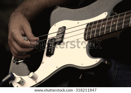 Detail of a musician playing electric guitar on concert - stock photo