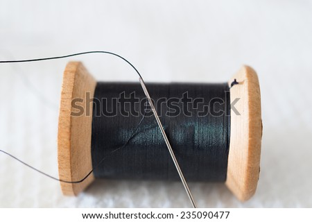 Detail of a needle with thread things - stock photo