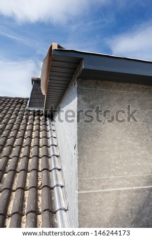 Detail of a new dormer corner built on a old house - stock photo
